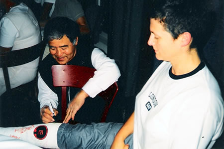 Higaonna Shihan signing my cast after I snapped my achilles tendon, Sweden 2000