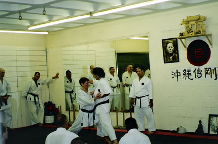 Sensei Linda Marchant training under the guidance Higaonna Shihan at Sensei George's Institute of Traditional Karate-do in 2003